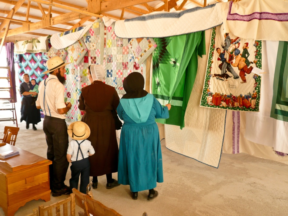 Amish visitors admire the craftsmanship